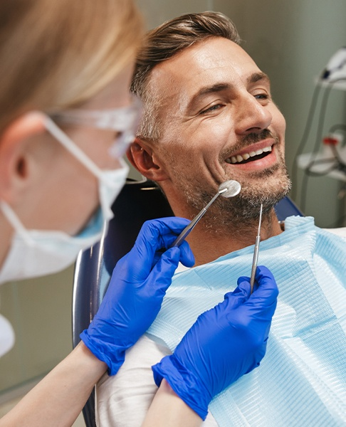 Man receiving dental checkup to prevent dental emergencies