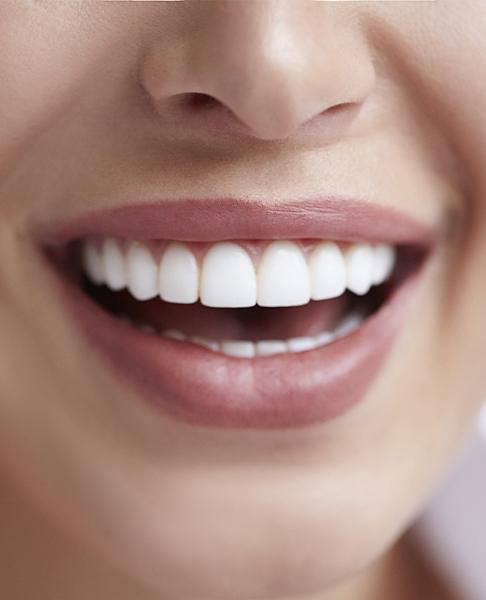 Closeup of healthy smile after gum disease treatment